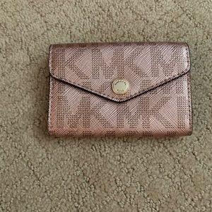 Women's rose gold Michael Kors wallet